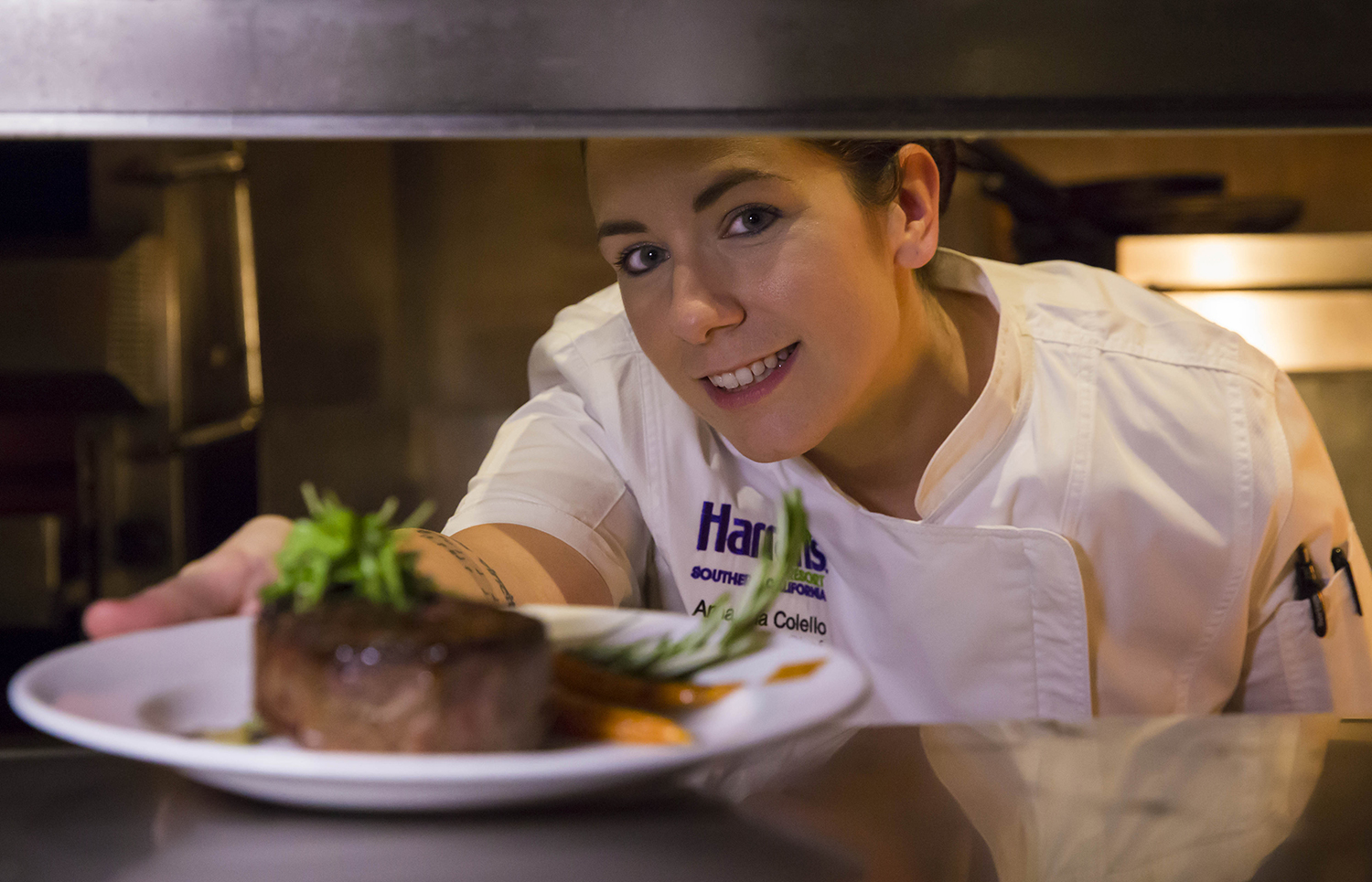 Chef Amanda Collelo serves up a dish for SD Restaurant Week.