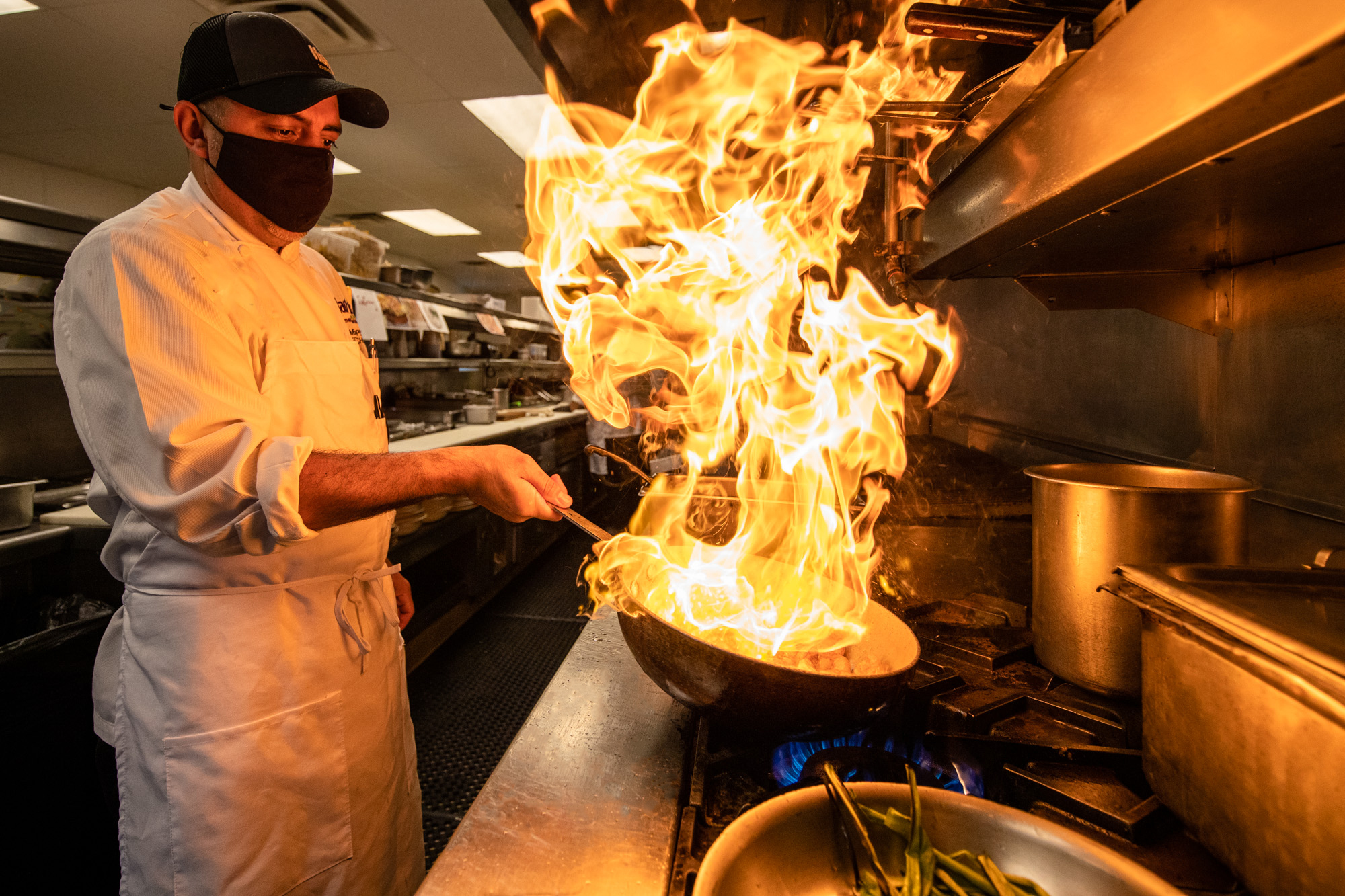 Chef Homero cooking up some fire!